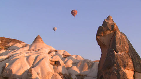 Hot Air Balloons Fly Over The Magnificent Geologic stock footage
