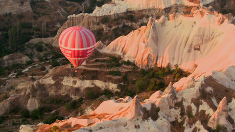 A high angle of hot air balloons flying over Cappa Footage