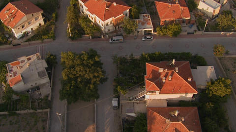 A slow aerial perspective over a neighborhood Stock Video Footage