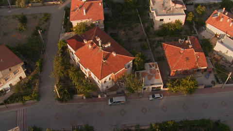 A slow aerial perspective over a neighborhood Footage