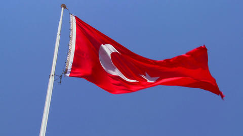 A Turkish flag flies near a mosque Stock Video Footage