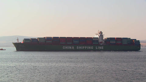 A Chinese cargo ship leaves China loaded with cont Footage