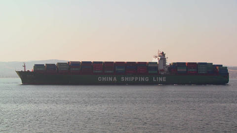 A Chinese cargo ship leaves China loaded with cont Stock Video Footage