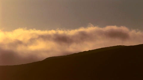 Time lapse shot of fog rolling off a mountain range Stock Video Footage