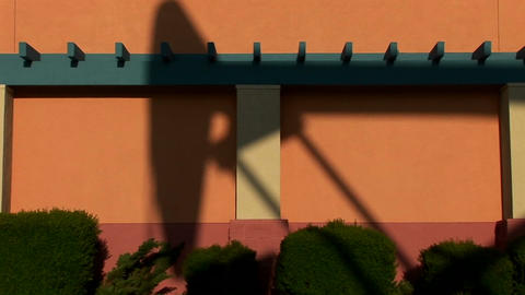 A giant oil rig casts a shadow against the side of a... Stock Video Footage