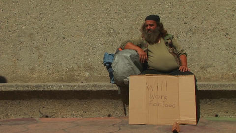 men hold up cardboard signs on the street Stock Video Footage