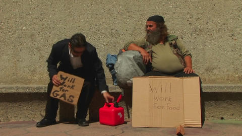 men hold up cardboard signs on the street Footage