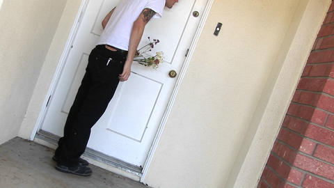 A tattooed man comes to the door for a date, rings the... Stock Video Footage
