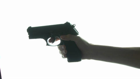 A gun is pointed at the camera Stock Video Footage