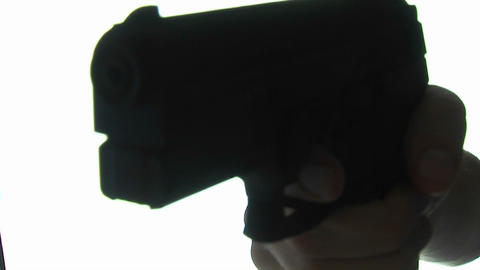 A gun is pointed at the camera Footage