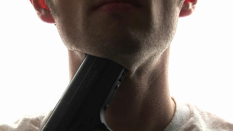 A man puts a pistol against his throat and pulls the trigger, committing suicide Footage