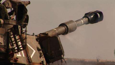 An army tank fires and recoils on a battlefield in the... Stock Video Footage
