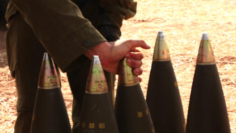 Israeli soldiers prepare shells to be fired during the... Stock Video Footage
