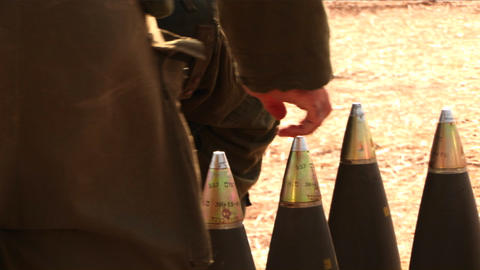 Israeli soldiers prepare shells to be fired during the war with Lebanon Footage