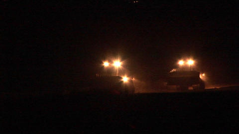A night patrol of armored bulldozers moves along the Gaza... Stock Video Footage