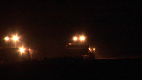A night patrol of armored bulldozers moves along the Gaza Strip on the Israel border Footage