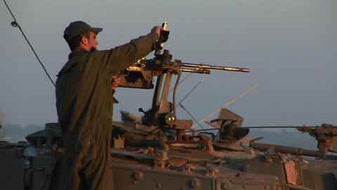 An Israeli soldier stands on a tank during a standoff at... Stock Video Footage