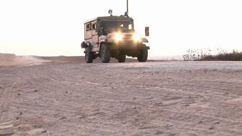 An Israeli army patrol moves along a border region Stock Video Footage