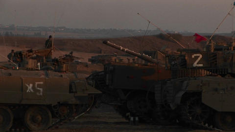 Israeli armored vehicles wait at an army staging post on... Stock Video Footage