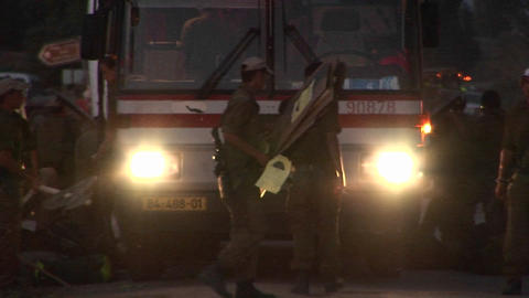 Israeli soldiers emerge from a transport bus at night in... Stock Video Footage