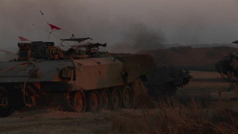 Israeli armored personnel carriers, roll into battle along the border with the Gaza Strip Footage