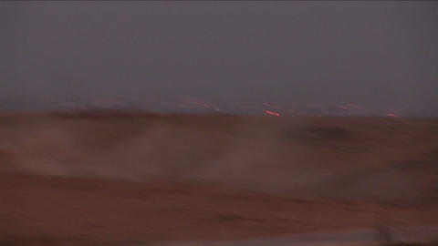 An Israeli tank moves across a no man's land between... Stock Video Footage