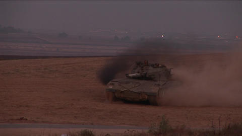 An Israeli tank moves across a no man's land between Israel and the Gaza Strip Footage