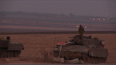A soldier climbs down from an Israeli tank Footage