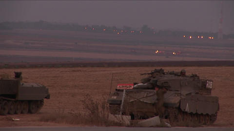 A soldier climbs down from an Israeli tank Stock Video Footage