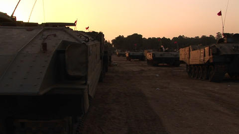 A line of armored vehicles sit on the Israel - Gaza Strip... Stock Video Footage