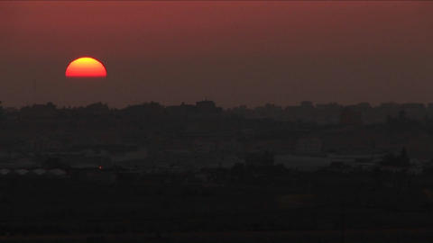 A multi colored sky over the Gaza border Footage
