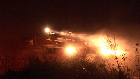 An Israeli army tank moves on patrol through a border region with high powered lights Footage