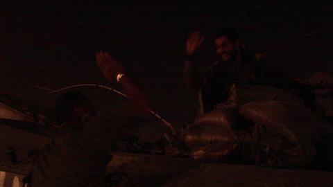Israeli soldiers on an army tank give each other a high... Stock Video Footage