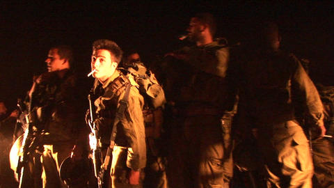 Israeli soldiers gather and smoke cigarettes Footage