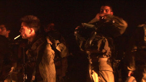 Israeli soldiers gather and smoke cigarettes Stock Video Footage