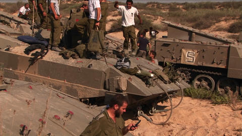 Israeli soldiers stand on top of their armored personnel... Stock Video Footage