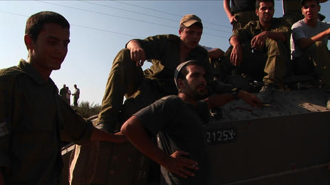Off duty Israeli soldiers sit on a tank talk Footage