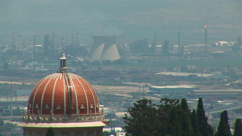 Power plants and the Baha'i temple dome are seen on the... Stock Video Footage