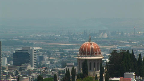 Power plants and the Baha'i temple dome are seen on the skyline of Haifa, Israel Footage