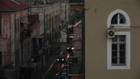 Traffic passes down a narrow street in Haifa, Israel Stock Video Footage