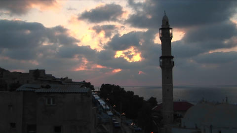 Clouds drift above the minaret of a mosque in Israel Stock Video Footage