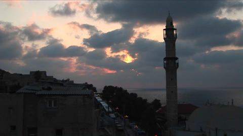 Clouds drift above the minaret of a mosque in Israel Footage