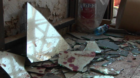 Blood stained pieces of broken glass lie scattered after a suicide bombing in the Middle East Footage