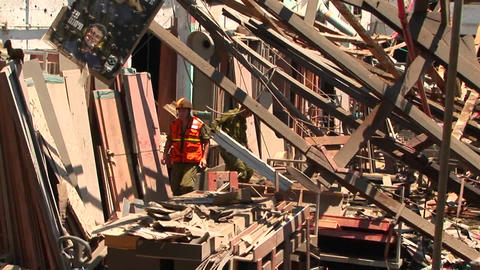 Workers walk through a damaged building in Haifa, after... Stock Video Footage