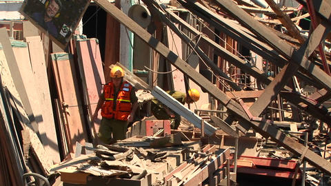 Workers walk through a damaged building in Haifa, after rocket attacks during the Israel - Lebanon w Footage