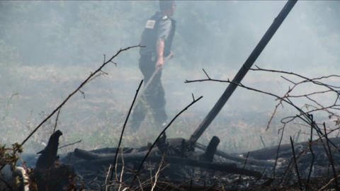 Israeli police and fire officials work to put out a fire... Stock Video Footage