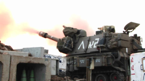 An Israeli army tank fires towards Lebanon during the... Stock Video Footage
