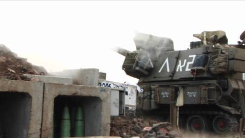 An Israeli army tank fires towards Lebanon during the Israel - Lebanon war Footage