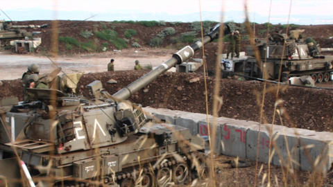 An Israeli army tank moves its barrel into firing position during the Israel - Lebanon war Footage