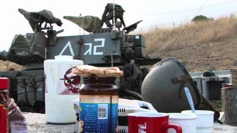 A table of rations stands next to an Israel army unit and their tank Footage